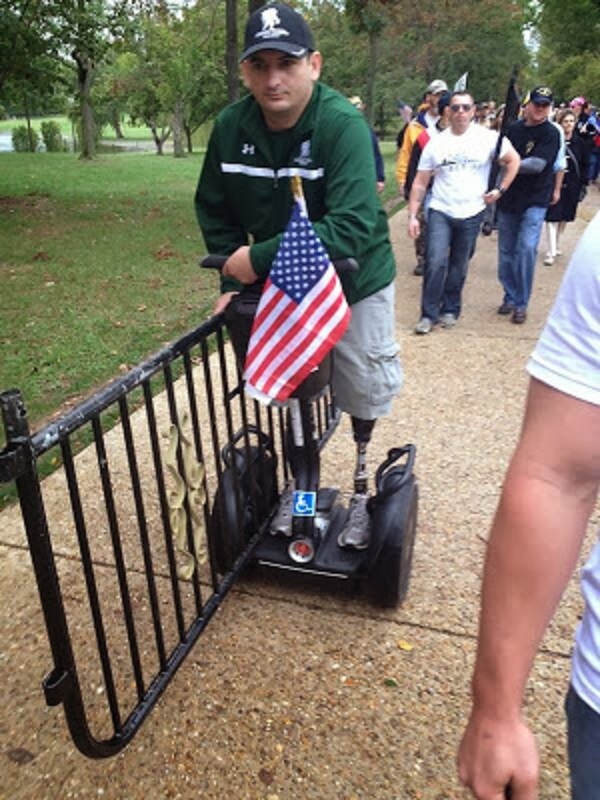 Taking a Barrycade to the White House lawn during the Million Vet March - 10.13.2013 - 600X800